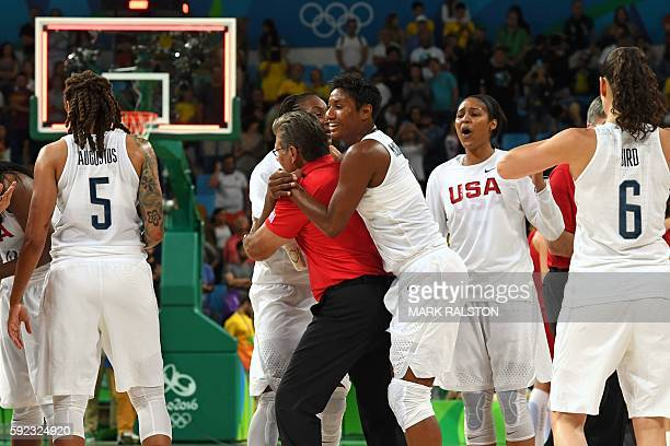 USA's small forward Angel Mccoughtry celebrates with USA's head coach Geno Auriemma after USA defeated Spain during a Women's Gold medal basketball...