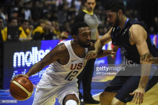 USA's small forward Darrun Hilliard II drives the ball marked by Argentina's small forward Patricio Garino during their 2017 FIBA Americas...