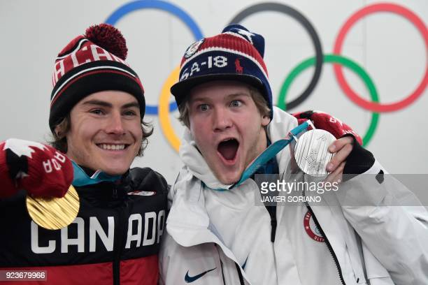 TOPSHOT USA's snowboard big air silver medallist Kyle Mack and Canada's gold medallist Sebastien Toutant pose with their medals backstage at the...