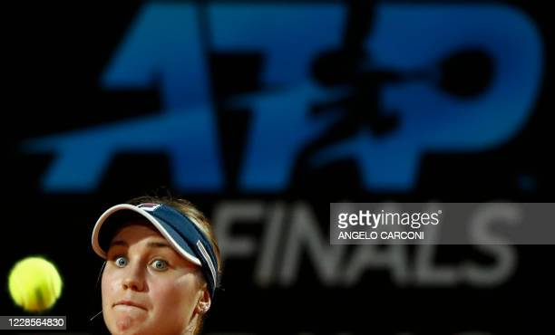 S Sofia Kenin eyes the ball as she returns to Belarus' Victoria Azarenka on day four of the Women's Italian Open at Foro Italico on September 17,...