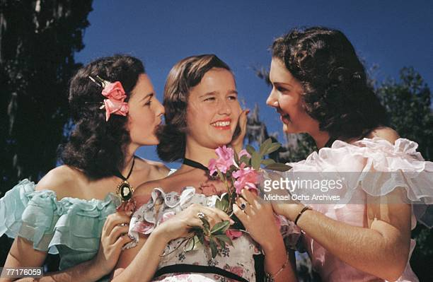 MID 1930's Southern Belles enjoy themselves during a recreation of pre Civil War life on a plantation circa mid 1930's in the deep south