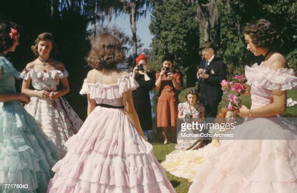 MID 1930's Southern Belles pose for photographers during a recreation of pre Civil War life on a plantation circa mid 1930's in the deep south