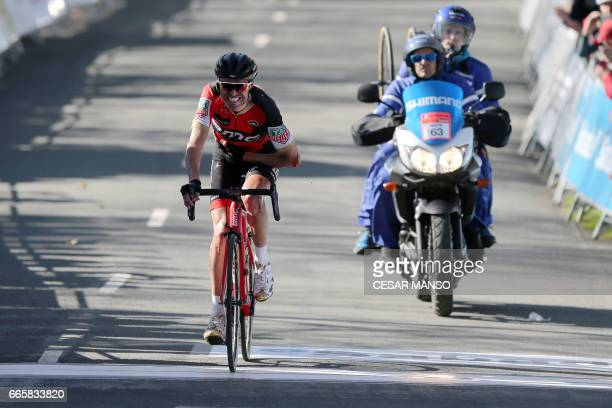 BMC's Spanish rider Samuel Sanchez crosses the finish line after falling down during the fifth stage of the 2017 Tour of the Basque country a 1398km...