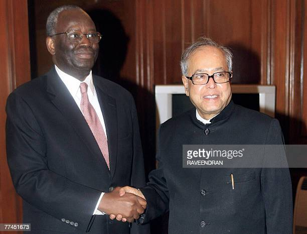 UN's special envoy to Myanmar Ibrahim Gambari shakes hands with Indian External Affairs Minister Pranab Mukherjee during a meeting at the Ministry of...
