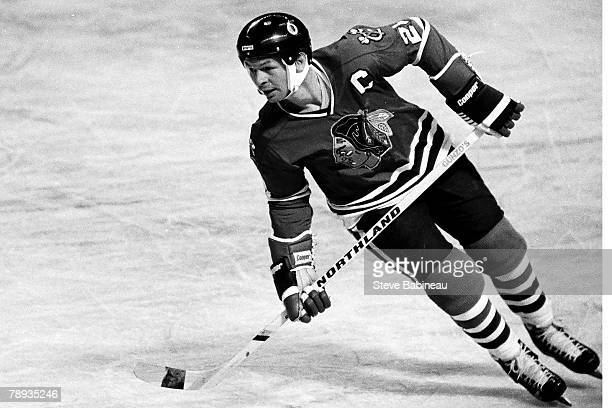 Stan Mikita of the Chicago Blackhawks plays against the Boston Bruins .