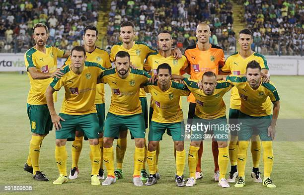 AEK's starting eleven pose for a group picture ahead of their qualifying football match of the UEFA Europa League between AEK Larnaca and Slovan...