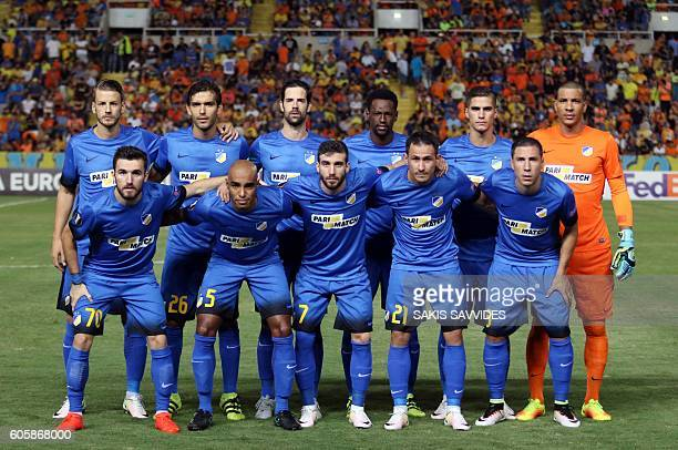 APOEL's starting eleven pose for a group picture ahead of their UEFA Europa League Group B football match between Cyprus' APOEL Nicosia and...