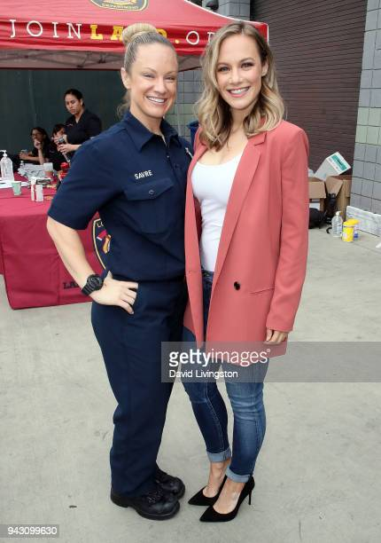 ABC's Station 19 cast member Danielle Savre poses with her sister/LAFD member Stephanie Savre at LAFD Girls Camp on April 7 2018 in Panorama City...