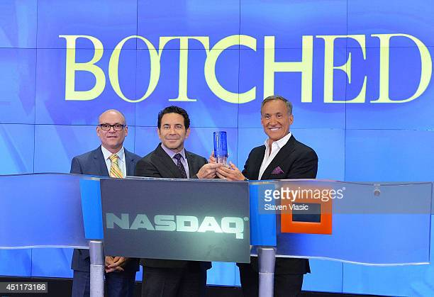 NASDAQ's Steven Brown with Dr Paul Nassif and Dr Terry Dubrow the cast of 'Botched' ring the closing bell at NASDAQ MarketSite on June 24 2014 in New...