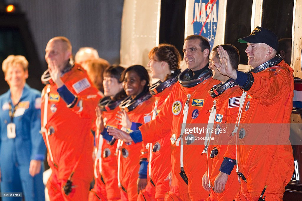 NASA's STS-131 astronauts (R-L) Commander Alan Poindexter, Pilot James P. Dutton Jr., mission specialists Rick Mastracchio, Dorothy Metcalf-Lindenburger, Stephanie Wilson, Japan Aerospace Exploration Agency astronaut Naoko Yamazaki and NASA astronaut Clayton Anderson walk out of the operations and checkout building at Kennedy Space Center April 5, 2010, in Cape Canaveral. The shuttle crew is scheduled to launch later today for a 13 day trip to the International Space Station.