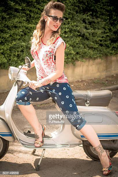 1950's style - pretty tattoed woman on vintage scooter - pjphoto69 個照片及圖片檔