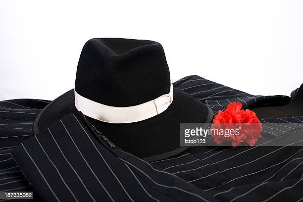 1920's style suit red carnation in lapel and stylish hat.