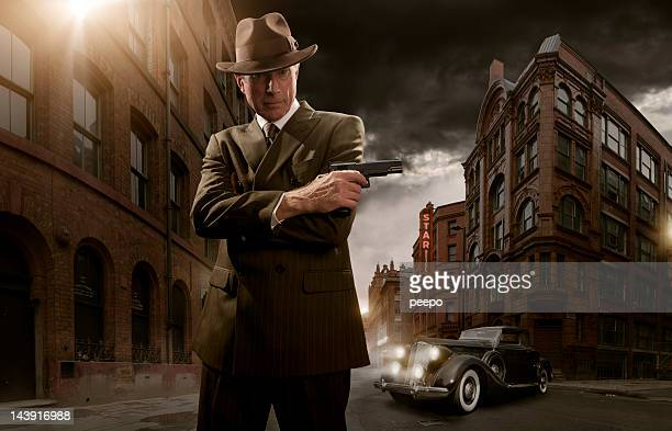 1940's stylised film noir gangster - gangster stock pictures, royalty-free photos & images