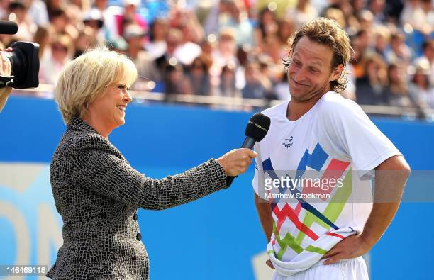 S Sue Barker interviews David Nalbandian of Argentina after being disqualified for unsportsmanlike conduct during his mens singles final round match...