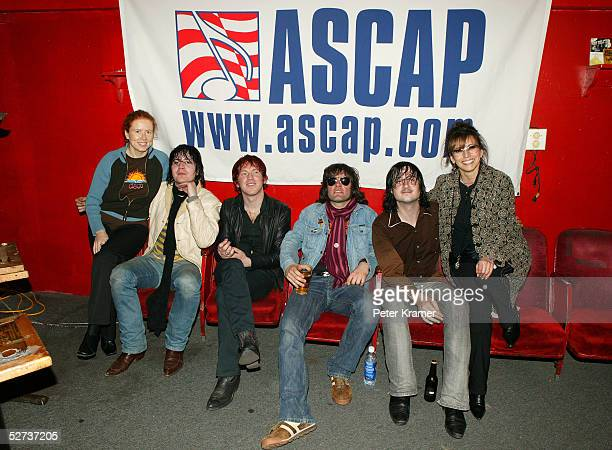 ASCAP's Sue Devine and Loretta Munoz pose with Nic Armstrong and the Thieves at The ASCAP Music Lounge at the Tribeca Film Festival April 29 2005 in...