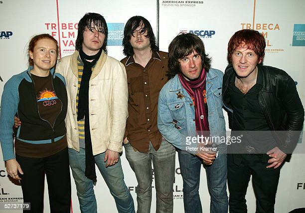 ASCAP's Sue Devine Nic Armstrong and the Thieves pose for a photo at The ASCAP Music Lounge at the Tribeca Film Festival April 29 2005 in New York...