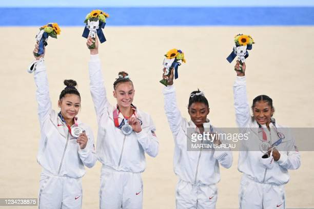 S Sunisa Lee, USA's Grace McCallum, USA's Simone Biles and USA's Jordan Chiles celebrate winning the silver medal during the podium ceremony of the...