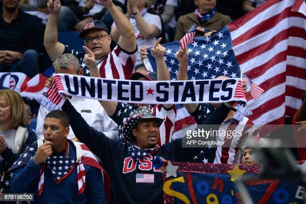 USA's supporters cheer as USA's Sloane Stephens plays against Belarus' Aliaksandra Sasnovich on November 12 2017 in Minsk during the Fed Cup final...
