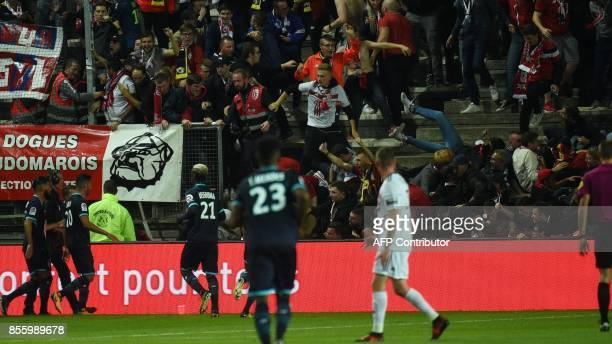 LOSC's supporters react as their tribune collapse following the goal by LOSC French defender Fode BalloToure during the French L1 football match...