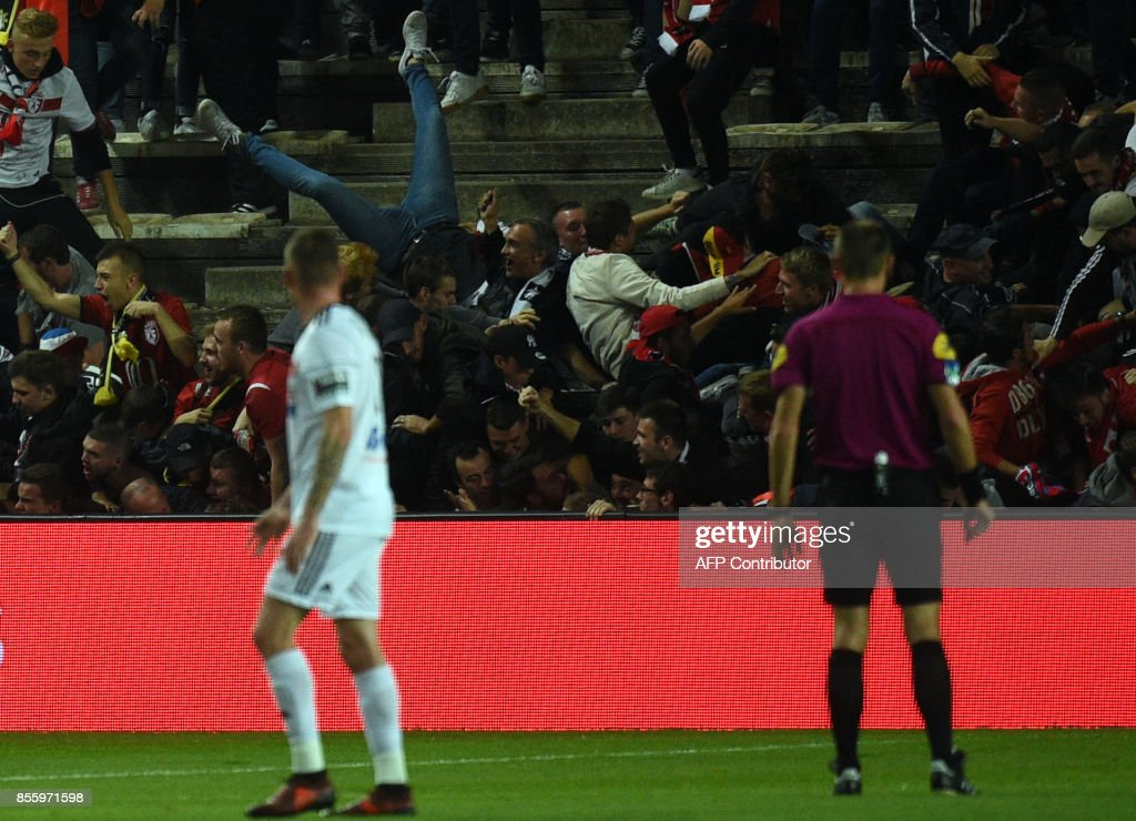 LOSC's supporters react as their tribune falls down following the goal by LOSC French defender Fode Ballo-Toure during the French L1 football match between Amiens and Lille LOSC on September 30, 2017 at the Licorne stadium in Amiens. /