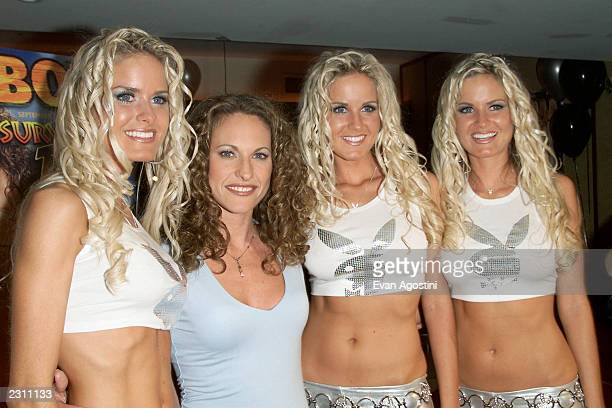 TV's Survivor Jerri Manthey poses with the Dahm triplets at a Playboy party thrown to celebrate her nude pictorial in the September 2001 issue at...