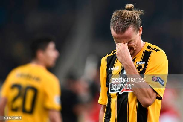 AEK's Swedish midfielder Niklas Hult reacts after being defeated by Benfica at the end of their UEFA Champions League Group E football match AEK...