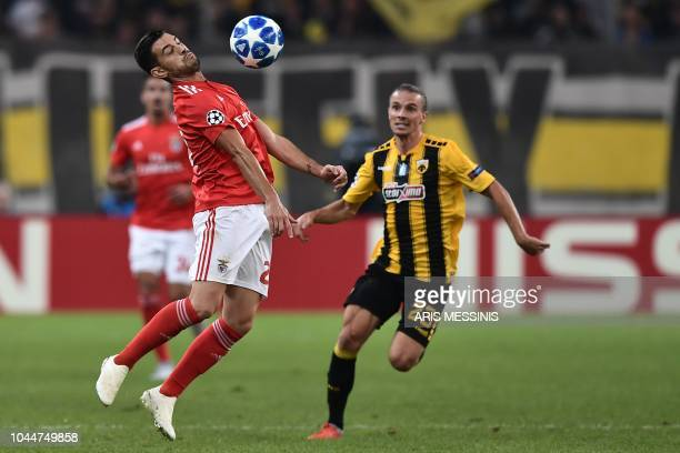 AEK's Swedish midfielder Niklas Hult vies with Benfica's Spanish defender Alex Grimaldo during their UEFA Champions League Group E football match AEK...