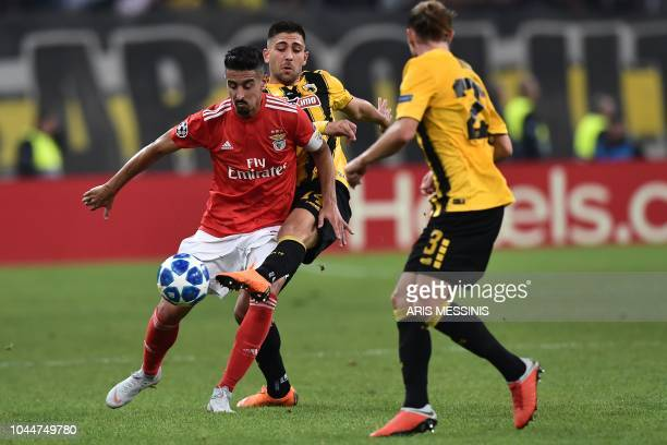 AEK's Swedish midfielder Niklas Hult vieswith Benfica's Portuguese defender Andre Almeida during their UEFA Champions League Group E football match...