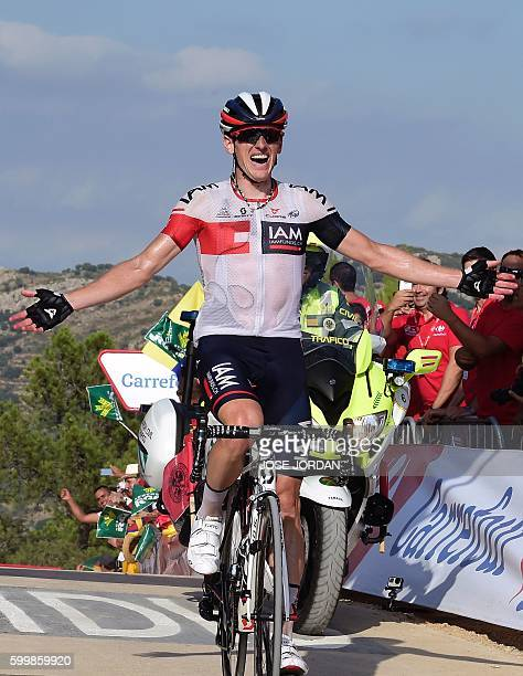 IAM's Swiss cyclist Mathias Frank celebrates after winning the 17th stage of the 71st edition of 'La Vuelta' Tour of Spain a 1733km route Castellon...