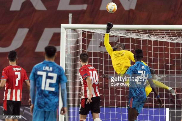 S Swiss goalkeeper Yvon Mvogo punches the ball during the UEFA Europa League round of 32 second-leg football match between PSV Eindhoven and...