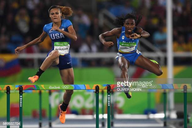 USA's Sydney Mclaughlin and Italy's Ayomide Folorunso compete in the Women's 400m Hurdles Round 1 during the athletics event at the Rio 2016 Olympic...