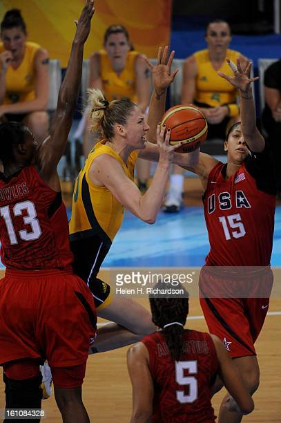 USA's Sylvis Fowles #13 left and Lauren Jackson #15 right try to block Australia's Suz Batkovic #8 from making a basket The US women's basketball...
