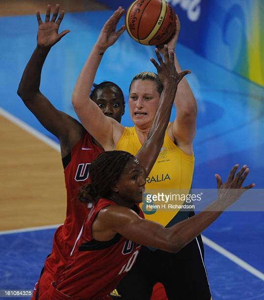 USA's Sylvis Fowles left and Tamika Catchings middle try to keep Australia's Suz Batkovic #8 from passing the ball The US women's basketball team...