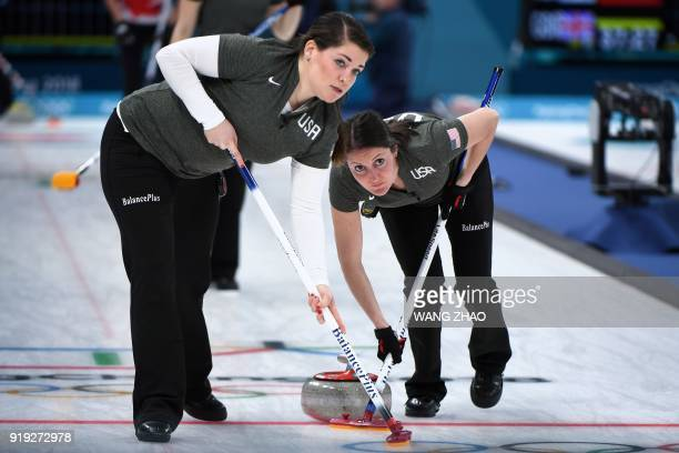 USA's Tabitha Peterson and Becca Hamilton brush in front of the stone during the curling women's round robin session between the the US and Canada...