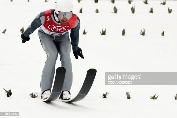 S Taylor Fletcher competes in the nordic combined men's individual NH/10km jumping trial round at the Alpensia ski jump centre during the Pyeongchang...