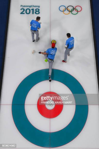 USA's team competes during the curling men's gold medal game during the Pyeongchang 2018 Winter Olympic Games at the Gangneung Curling Centre in...
