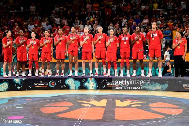 USA's team listen to their national anthem as they celebrate on the podium with their gold medals after the FIBA 2018 Women's Basketball World Cup...