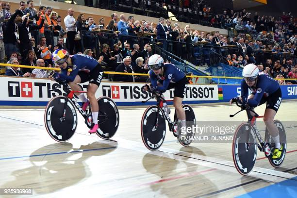 USA's team members cross the finish line to win the women's pursuit final during the UCI Track Cycling World Championships in Apeldoorn on March 1...