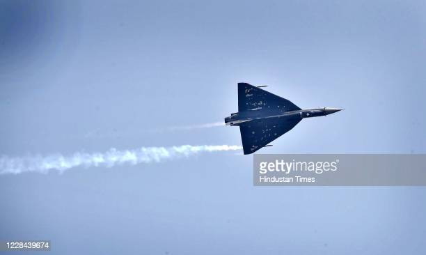 S Tejas aircraft flies during the Rafale induction ceremony on September 10, 2020 in Ambala, India. The aircraft will be part of 17 Squadron, the...