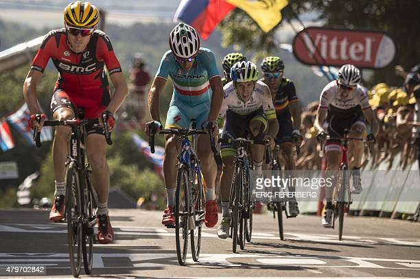 S Tejay Van Garderen and Italy's Vincenzo Nibali react as they cross the finish line at the end of the 159.5 km third stage of the 102nd edition of...