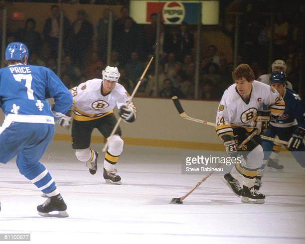 BOSTON MA 1980's Terry O'Reilly of the Boston Bruins skates with puck against the Quebec Nordiques in game at the Boston Garden in Boston...
