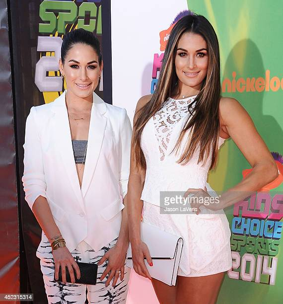 WWE's The Bella Twins and TV personalities Brianna Danielson and Nicole GarciaColace attend the 2014 Nickelodeon Kids' Choice Sports Awards at Pauley...
