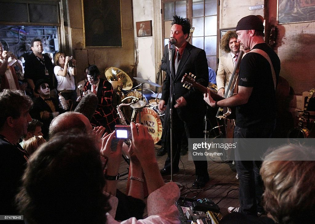 U2's The Edge (R) performs with the Preservation Hall Jazz Band during the grand re-opening of Preservation Hall on April 27, 2006 in New Orleans, Louisiana. Preservation Hall has been closed since Hurricane Katrina hit the area eight months ago.