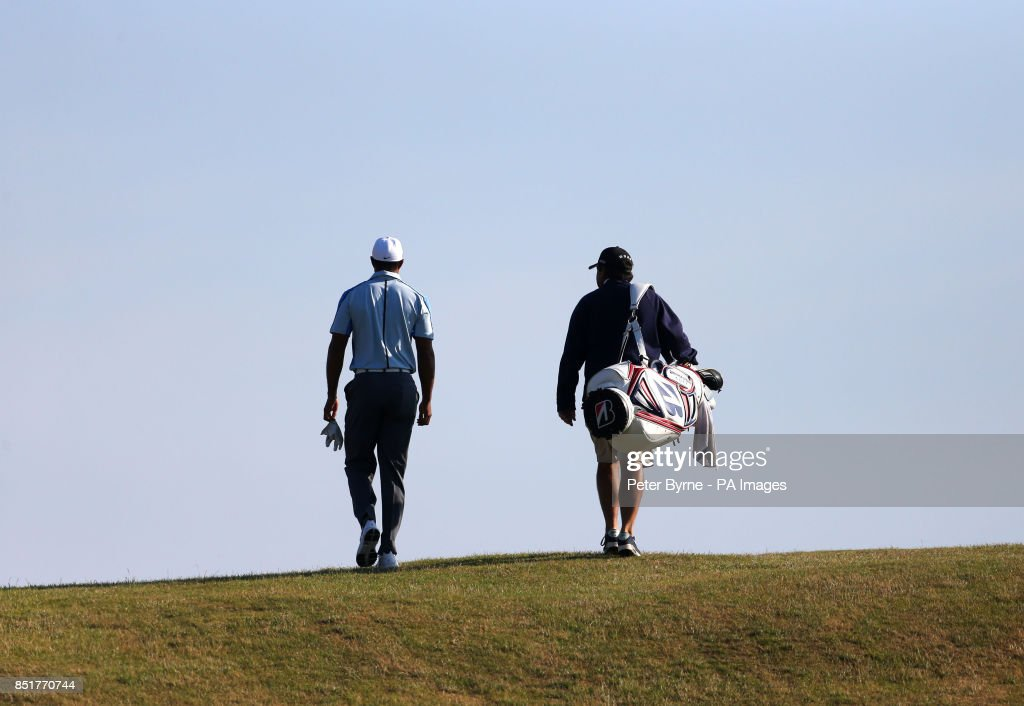 USA's Tiger Woods with caddie Joe LaCava during practice day four for the 2013 Open Championship at Muirfield Golf Club, East Lothian.