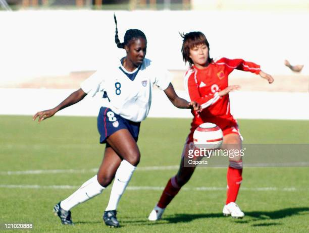 S Tina Ellertson and China's Han Duan in action during the group B Algarve Cup match between the USA and China at Municipal Stadium in Silves,...