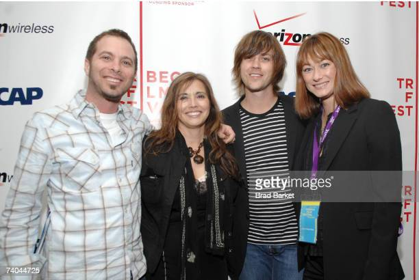 S Tom Desavia, ASCAP's Loretta Munoz, musician Rhett Miller, and wife model Erica Iahn pose at the ASCAP Tribeca Music Lounge held at the Canal Room...