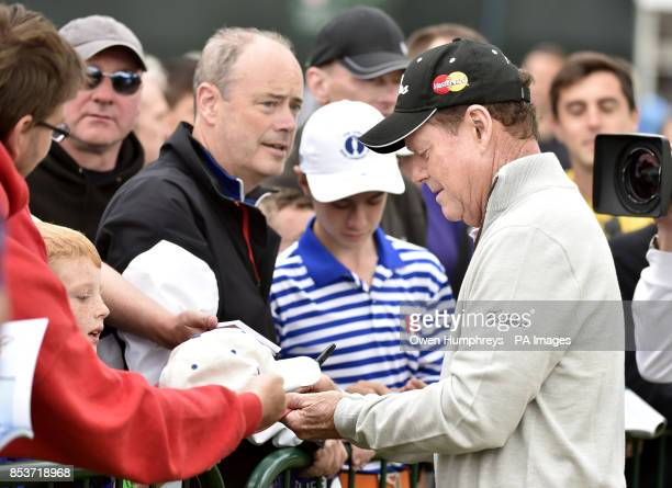 USA's Tom Watson signs autographs during day three of the 2014 Open Championship at Royal Liverpool Golf Club Hoylake