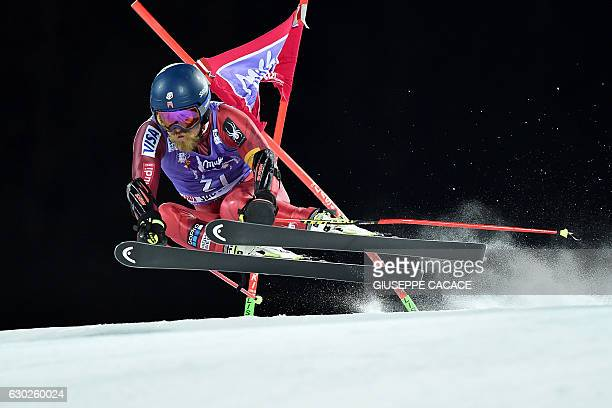 USA's Tommy Ford competes in the Men's Parallel Giant Slalom at the FIS Alpine World Cup in Alta Badia in the Italian Alps on December 19 2016 / AFP...