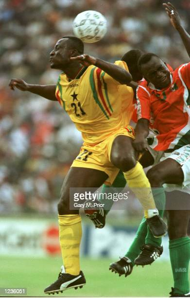 UNITED's TONY YEBOAH PLAYING FOR GHANA IS CHALLENGED BY IVORY COAST DEFENDERS DURING GHANA's 20 VICTORY TODAY AT PORT ELIZABETH IN THE 1ST ROUND OF...