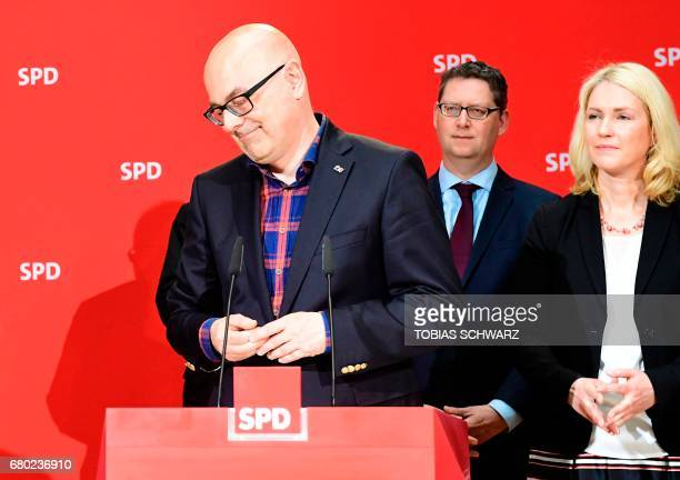 SPD's topcandidate in SchleswigHolstein Torsten Albig delivers a statement at the party's headquarter next to German Family Minister Manuela Schwesig...